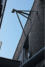 Pulley remaining from H. R. Binnie's blacksmith shop behind the Bishop Hotel  on First Avenue N