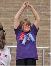 Ruthie received blue ribbons for the standing long jump and the 50m walk, a red ribbon for the softball throw.
