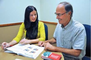 Barbara Wojciechowska improves her English by discussing topics of interest with John Gee.