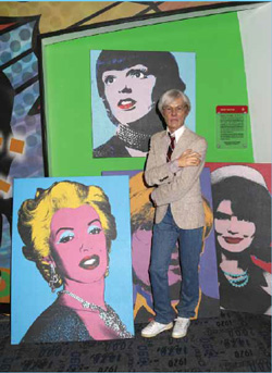 A wax figure of Andy Warhol is seen on display at Madame Tussauds on December 6, 2013 in New York City.