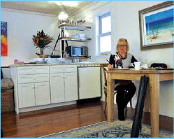 Jenny Bleackley painting at home