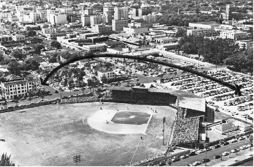 Ruth hit an amazing 624-foot home run from old Waterfront Park Stadium to the West Coast Inn at the southwest corner of 1st Street and 3rd Avenue, near today's Hilton Hotel.  This photo depicts the distance.  Waterfront Park Stadium's home plate is near the center of Al Lang parking lot. Photo is of the first Al Lang Stadium, image 1950.  Courtesy of St. Petersburg Museum of History.