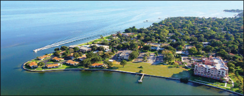 At the north end of Bahama Shores, on Little Bayou, is the Westminster Shores Retirement Community. This was originally the site of the Bahama Beach Hotel and Yacht Club built by Robert Lyons in 1947. One of the architects was William Harvard, Sr., who later went on to build the bandstand at Williams Park, the Central Library, and the Inverted Pyramid Pier. Some of the original hotel bungalows may be seen in the lower left. (Courtesy of Richard Brashear of Westminster Shores)