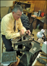 Jim Watters at the  engraving machine