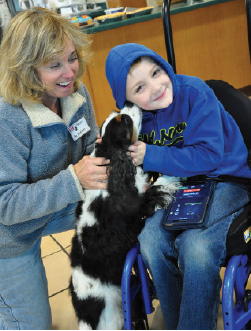 Ann Goldman and Lacie (therapy dog) brighten the day for Cooper Hicks