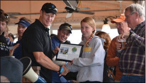 "Commander Doolittle (SEAL) presenting Reagen Quilty with the ""Spirit of the Naked Warrior"" award. Naked refers to 'without lifelines, using facemasks, and wearing only swim trunks and fins.'"