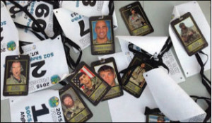 Lanyards with a picture and information about a fallen SEAL which each participant is given