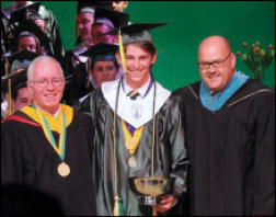 Jackson accepting the Most Outstanding Senior Award, with Shorecrest Headmaster Mike Murphy (left) and U.S. Principal Tom Dillow.
