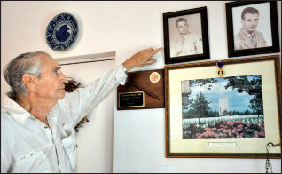 Judge O'Neil pointing to a photo of his brother, Charles
