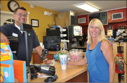 BP Old Northeast General Store patron Jennifer Ashley with owner Steve May