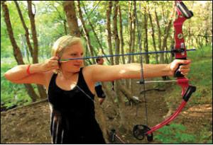 WOLF camper in archery training