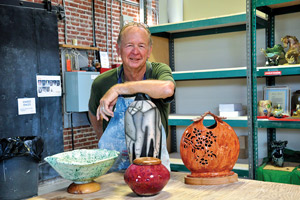 Tom Davis and some of his finished pottery