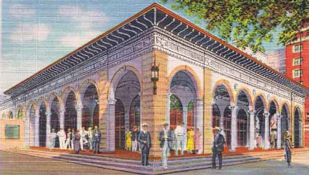 "Dating from 1916, the Open-Air Post Office was designed by Postmaster Roy S. Hanna and architect George Stuart. The post office was added to the National Register of Historic Places in 1975 and designated a local landmark in 1986. This postcard's obverse notes ""tremendous"" post office business conducted during the winter months ""when the city has 300,000 winter visitors, many times its normal population."" Circa 1930."