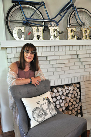 Robin Roth-Murphy highlights her living room mantel with her favorite found object: a bicycle from the 1950s.