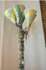 Robin used grandmother's old dress fabric to cover the shade of a standing lamp from Target. And she used tons of costume jewelry to adorn the entire column, a perfect example of Robin's unexpected ideas for design.
