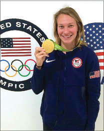 Melanie proudly holding her gold medal.