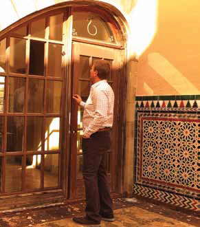 Nicholas Ekonomou examining the panes of the entryway