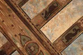 Aztec illustrations on cypress ceiling beams