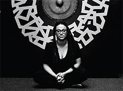 Ya La'ford at her ECHOES Solo Show at the Chihuly Collection museum