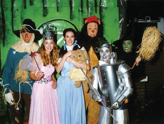 "Left: At age 21. Right: ""Me, my daddy, his daddy, and his daddy."" Above: Susan's family at one of their Halloween home productions. (Sean, Rachel, Rebekah, Ben, Susan, and Susanna."