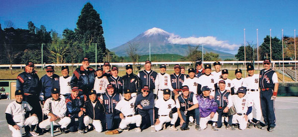 American and Japanese Senior Softball players near Mt. Fuji, Japan. The games in Japan were played at Honkawa School in Hiroshima, one of two cities in Japan that was devastated by atomic bombs in 1945.