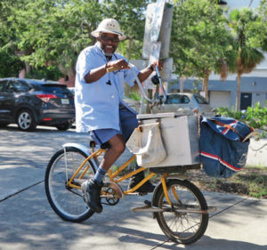 Tony Mells enjoys delivering mail by bicycle.