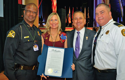 St. Pete Police Chief Anthony Holloway, Jo Brower, Mayor Rick Kriseman and Captain Franz Glenn Warner, Jr. of the Tampa Fire Department.