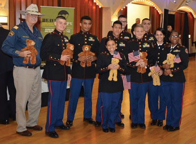 ROTC Marine Cadets from Tampa's Chamberlain High School with donated teddy bears.
