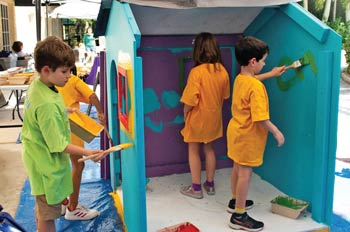 Kids add a creative touch to the playhouse.
