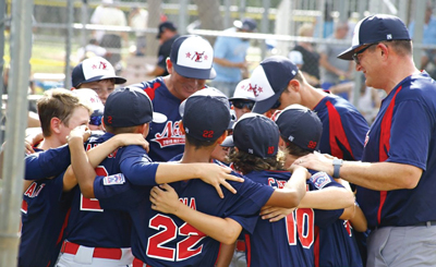 A Northeast Little League team in a huddle