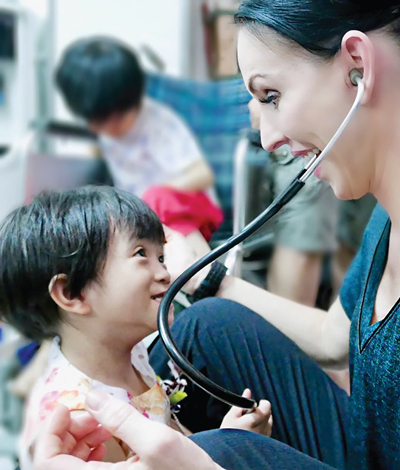 Dr. Anna Loyd with a child in Vietnam