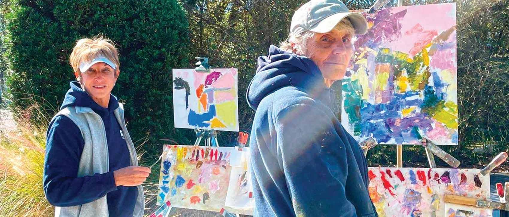 Hilda Neily with some of her artwork