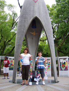 Julann and Jacob Baker on visit to Japan at the Sadasko Sasaki sculpture draped with origami cranes. Campbell Park Elementary School students made origami cranes to be draped on the sculpture.