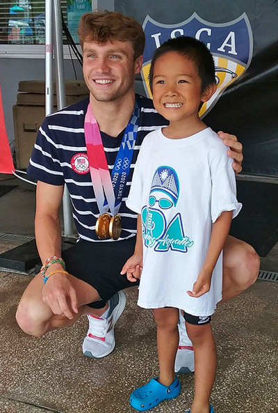 A young swim team member with Bobby